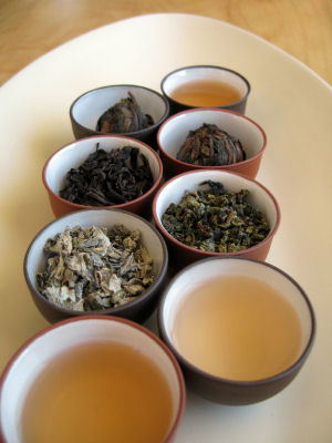 Quality dried Chinese tea leaves with freshly brewed tea � Liewy 2006 iStockphoto