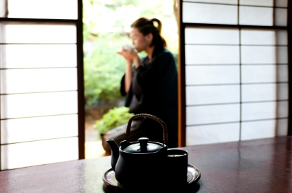 Japanese man drinking green tea © 101cats iStockphoto 2011