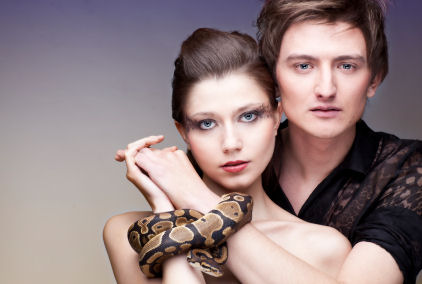 Couple with their hands connected with gorgeous royal python © 2007 by Anna Łotowska 2011 iStockphoto