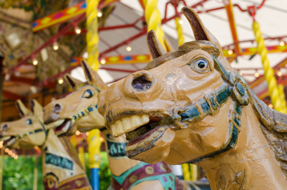 Wooden horses on an old carousel © by Sabastien_B 2013 iStockphoto