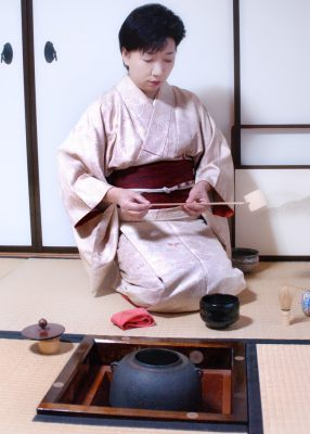 Woman conducting Japanese tea ceremony © Tony Aqualino