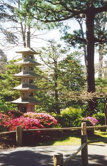 View of stone pagoda with azaleas