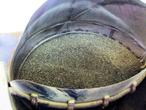 Machine for coaxing tea leaves into pellet shapes